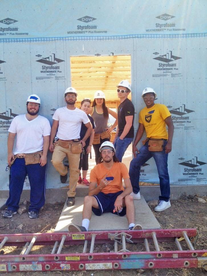 Photo courtesy of Scott Anderson. The Wesleyan chapter of Habitat for Humanity works on homes for the community. From left to right: Scott Anderson, Aaron Benavides, Debora Sainz, Sidney Mitchell, Forrest Kneten and Michael Thomas. Sitting is Philip Trammell.