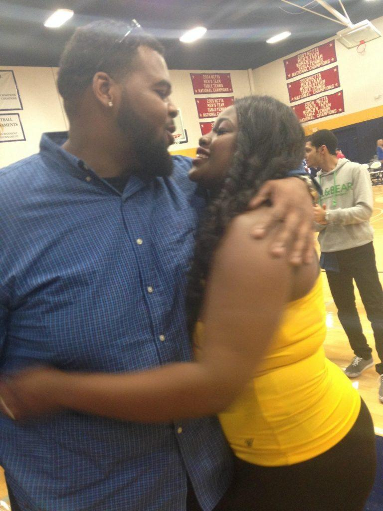 Homecoming Queen nominee Deja Chase with fiance Donald Ray Barnes after he proposed during halftime of the men's game. Photo by Dalise DeVos.