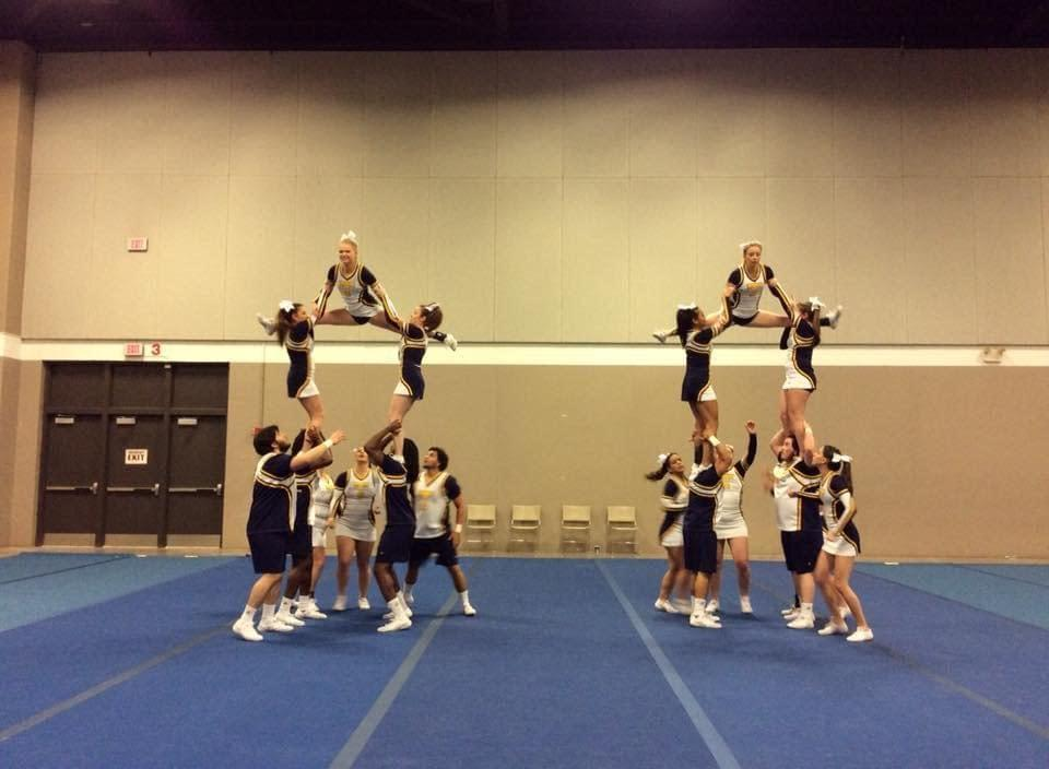 Cheerleaders move beyond the mat