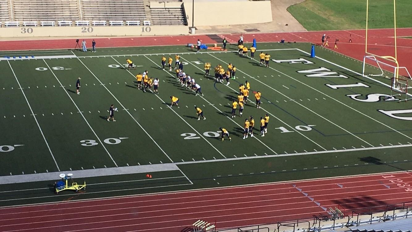 Football team practices in pads for the first time