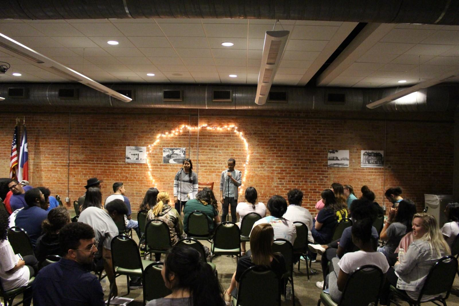 Students share poetry and songs at Naked But Real open mic