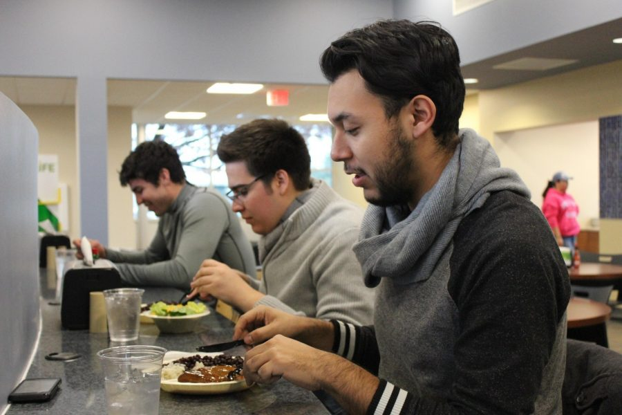 Senior theatre major Jacob E. Sanchez, sophomore theatre major Tyler Guse, and junior exercise science major Jonathan Bravo are the first three students to enjoy food in the new renovated Doras Dining Hall.