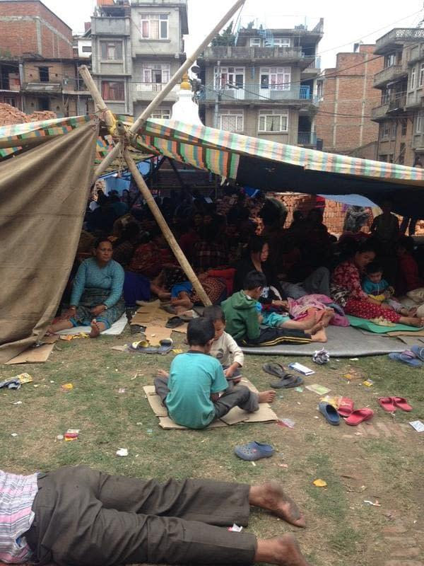 Refugees camp in a makeshift shelter in Patan after Saturdays earthquake.