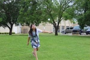 Freshman biology major, Nisha Bista plays badminton.