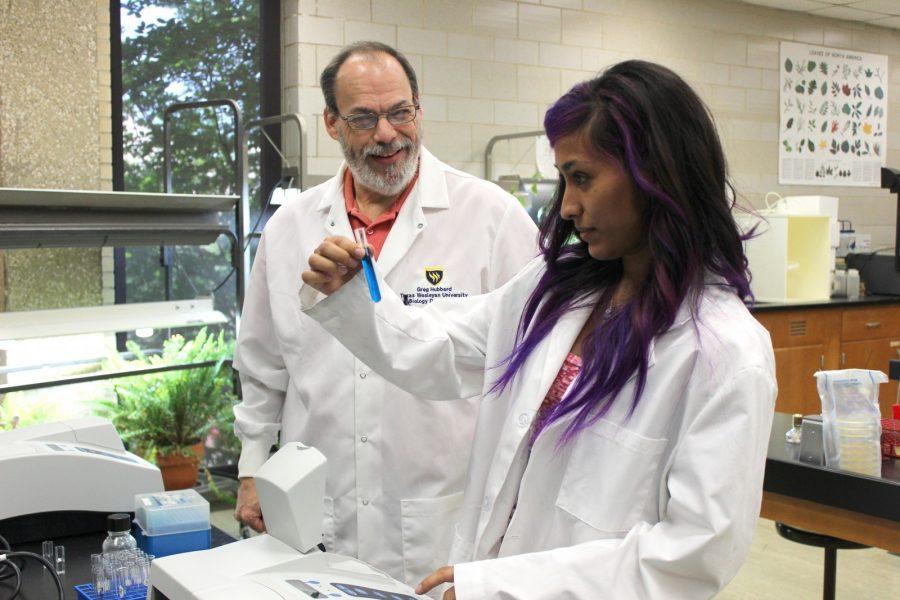 Biology lab cordinator Greg Hubbard (left) Maria Arreloa (right) work together
