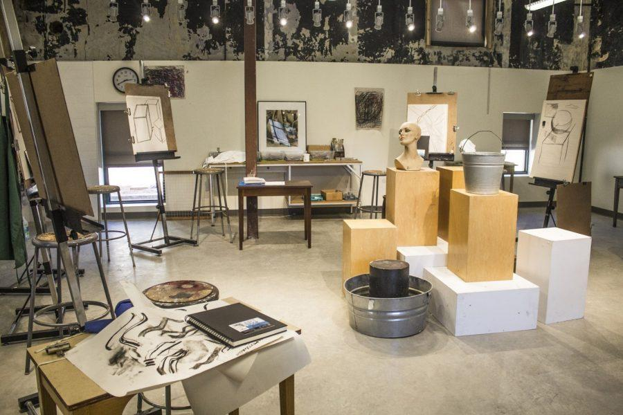 The main room in the Polytechnic Firehouse, now housing the art classes, used to hold the fire departments horses.