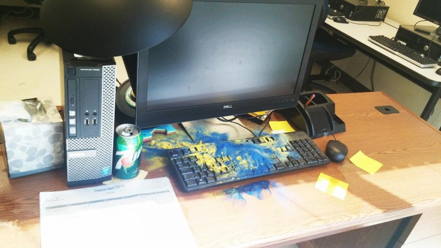 Photo courtesy of  Kristina Herd. The vandal poured sand and liquid on a keyboard.