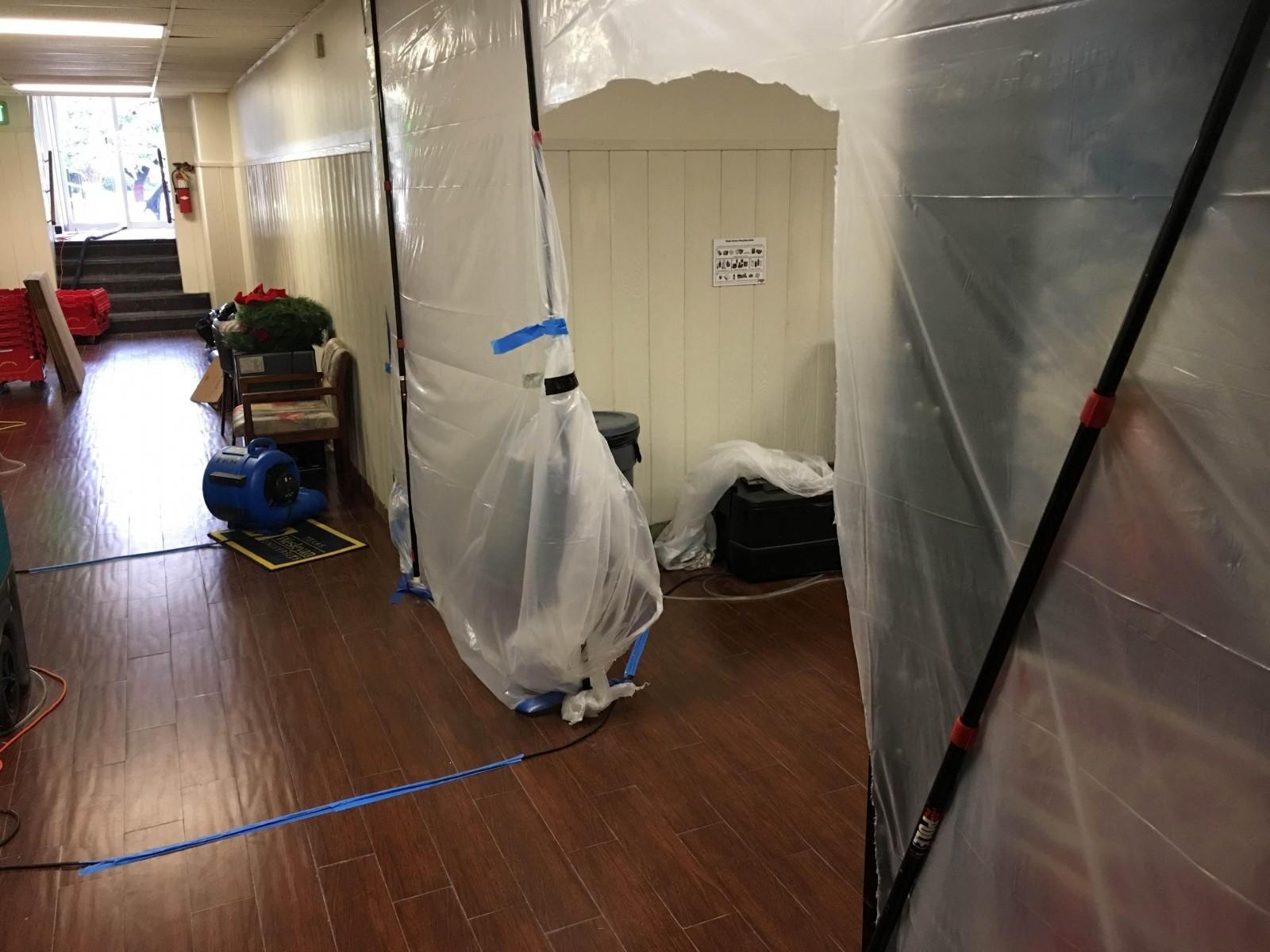 Photo by Ricardo Cortez Cleanup continues in the Oneal-Sells Administration Building.