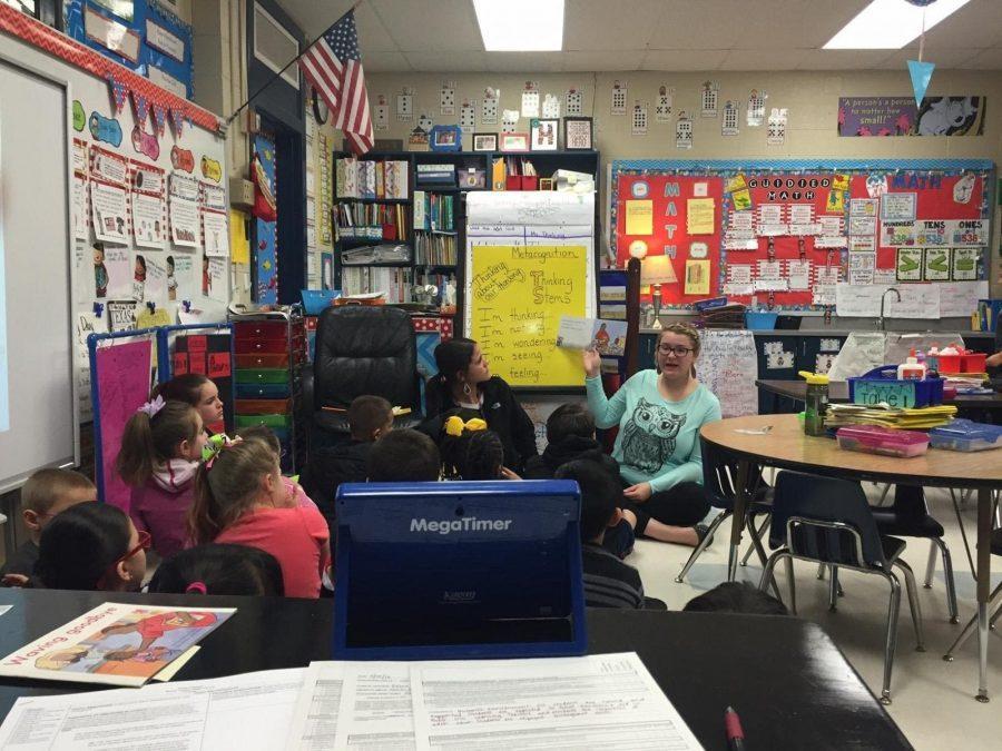 Senior Dylan Chandler teaching first grade with mentor Megan Hewitt.