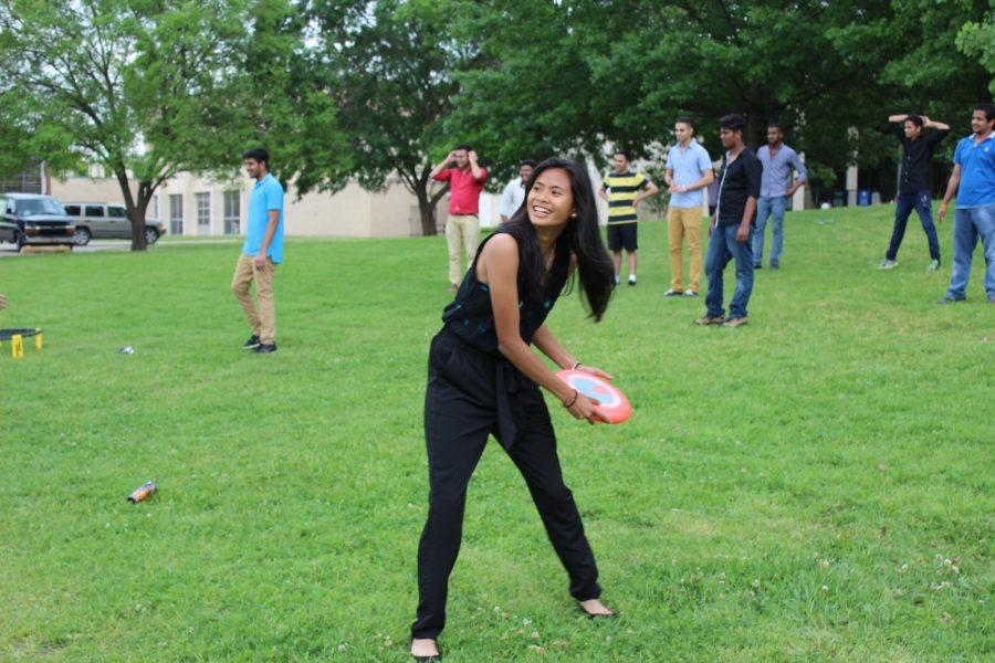 Texas Wesleyan student Becky Lavarn enjoys playing frisbee with other students in front of Dora's Dining Hall at Ram Jam 2015.