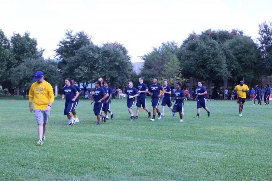 Members of the football team run together during the teams first practice. All photos by Karan Muns.