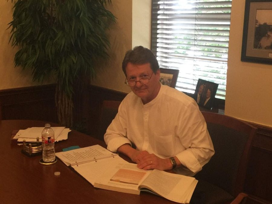Wesleyan President Frederick G. Slabach works on the curriculum for his business law class. Photo by Nicholas Acosta