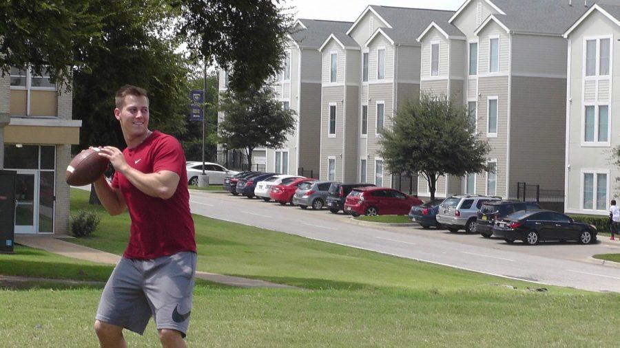 Quarterback Erik Richards practices outside Stella Russel Hall. (Photo by Karan Muns)