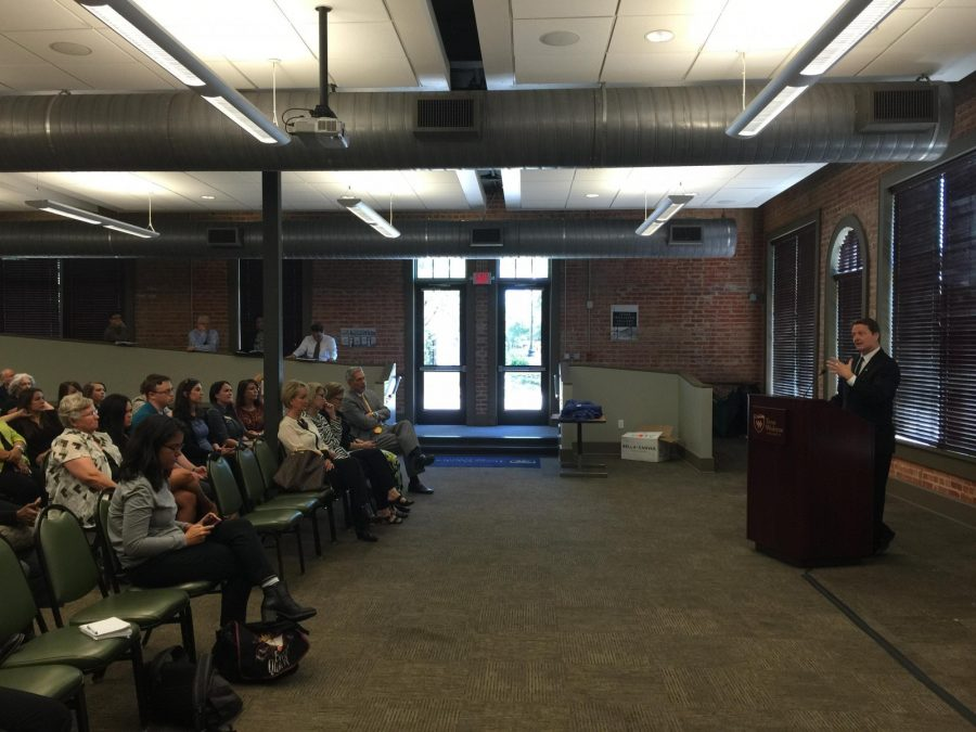 Wesleyan President Frederick Slabach talks at Tuesdays meeting at the Baker Building. Photo by Nicholas Acosta