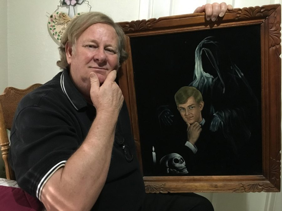 Alum and former staff member of Texas Wesleyan Terry Moon poses with a painting of himself.