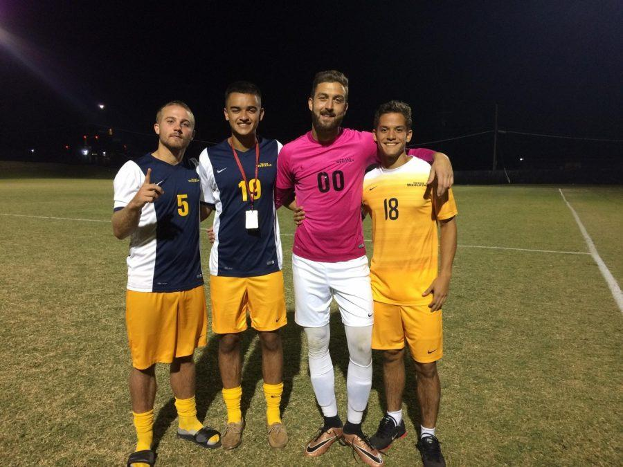 Mens+soccer+players+%28from+left%29+Micah+Day%2C+Hans+Soland%2C+Marko+Jovanovic%2C+and+Luis++Pumarejo+celebrate+after+their+Oct.+4+win+over+Mid-America+Christian+University.%0APhoto+by+Heather+Birge