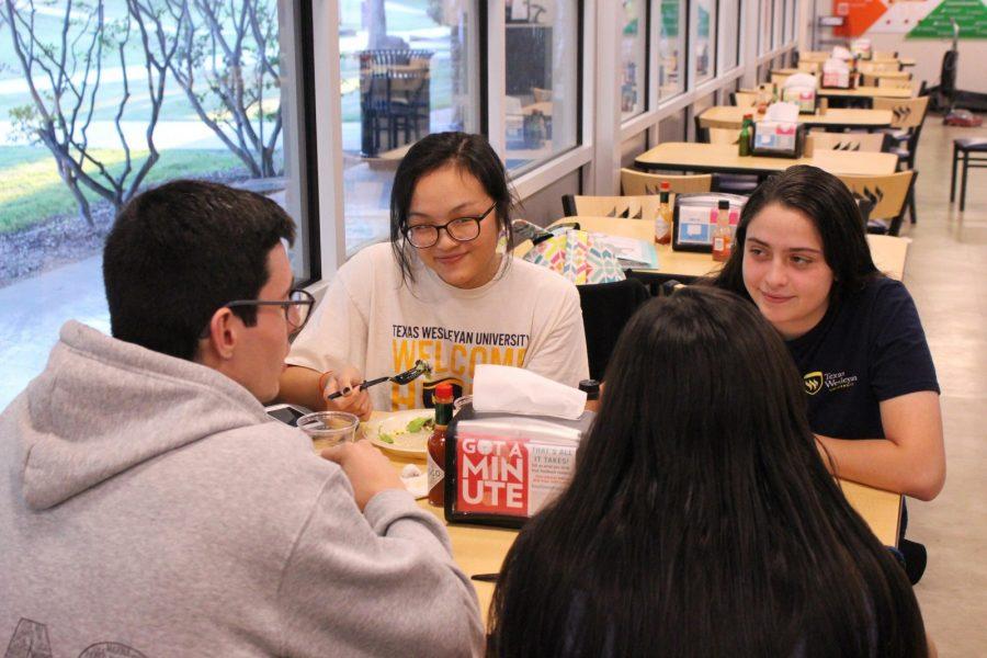 Freshman mass communication major Tina Huynh and other international students eat at Dora Roberts Dinning Hall.