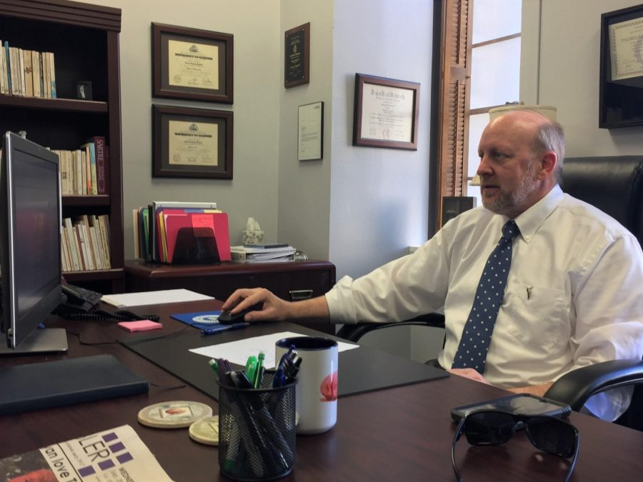 Dr. Steven Daniell works in his new office as Wesleyans associate provost.