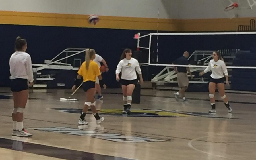 Morgan Reese (far right) practes with the womens volleyball team. Photo by Cheyan Fite