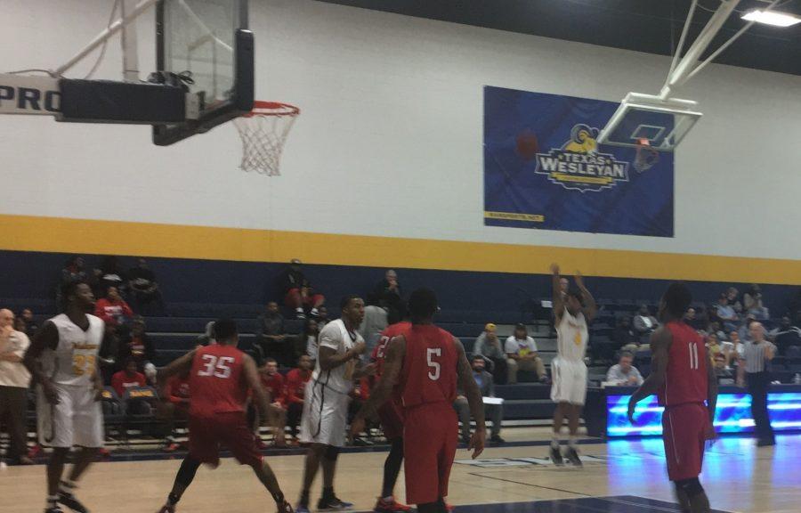 Senior guard Naiel Smith, a liberal studies major, makes a 3-point basket at Wesleyans game against Bacone College. Photo by Karan Muns