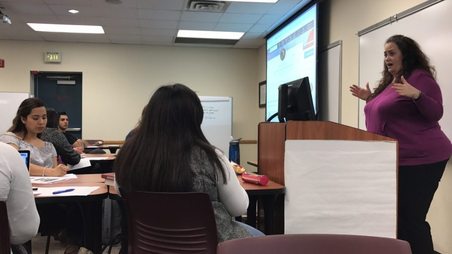 Texas Wesleyan University's student employment coordinator, Patricia Chastain, speaks to students about LinkedIn at the Beta Gamma Sigma workshop. Photo by April Suarez Olvera