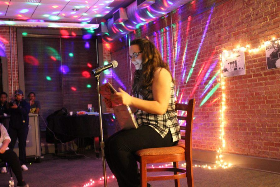 Senior English major Kime Sims performs an original poem at Naked but Real open mike event on Thursday. Photo by Hannah Onder