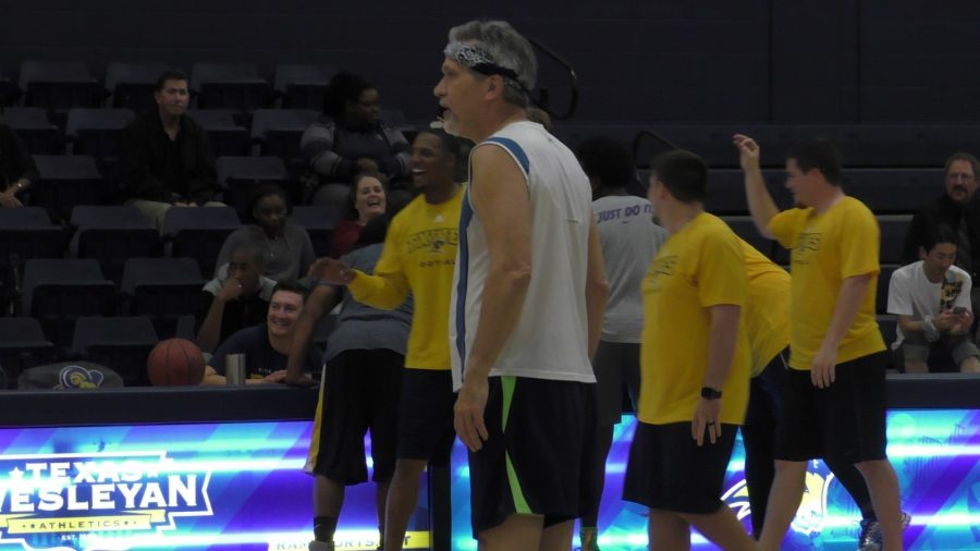 Jim Lewis stands guard for the faculty team during Thursdays game. Photo by Matt Smith