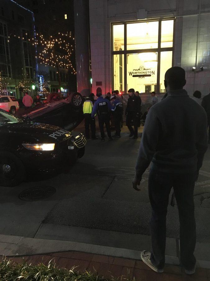 Cameron Bennett surveys the scene after a crash outside Sundance Square.