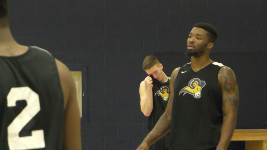 Jeremy Crane (center) and Najeal Young (right) at practice Monday for Tuesdays game against Mid-America University.  Photo by Matt Smith