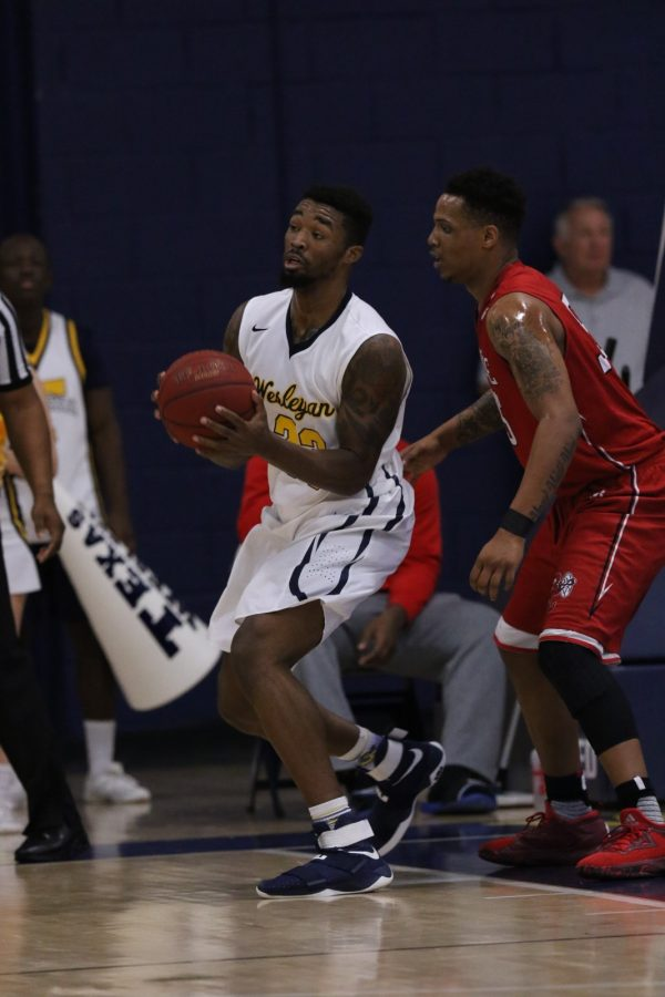 Najeal Young playing in Wesleyans game against Mid-America Christian on Feb. 28. Photo by Little Joe.