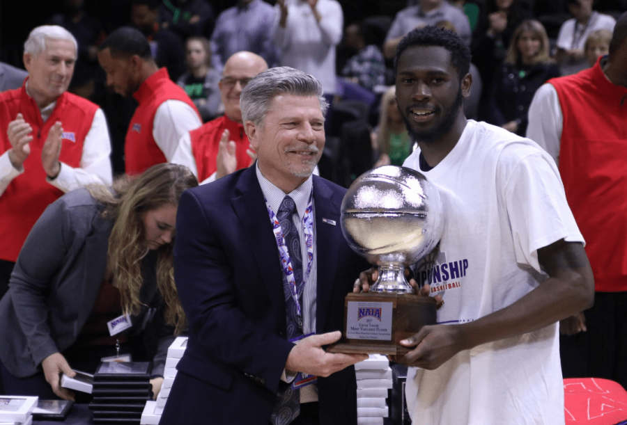 Dion Rogers holding the MVP award after the game.  Photo by Josh Lacy