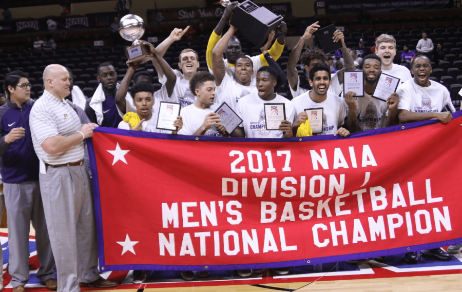 The team holding their banner after the game at Kansas City, MO in the Municipal Auditorium.