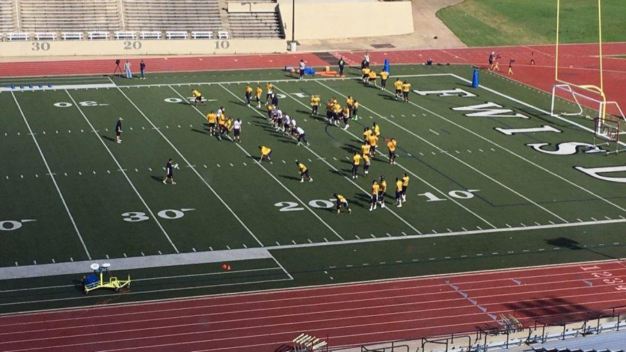 The football team practices in full pads at Farrington Field on Wednesday.  Photo by Iyanna Brown