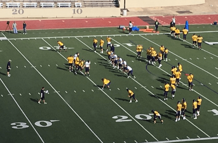 The team practices seven-on-seven on March 31 at Farrington Field. The Blue and Gold Game on April 22 will showcase all of the players.