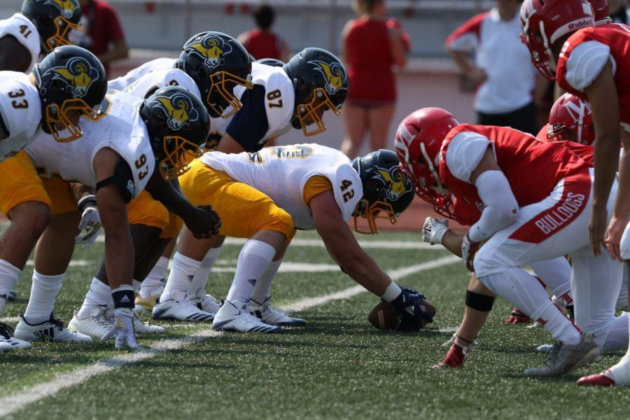 Jason Ramsland (93) sets up for a play against McPhersons defense on Sept. 9. Photo by Little Joe