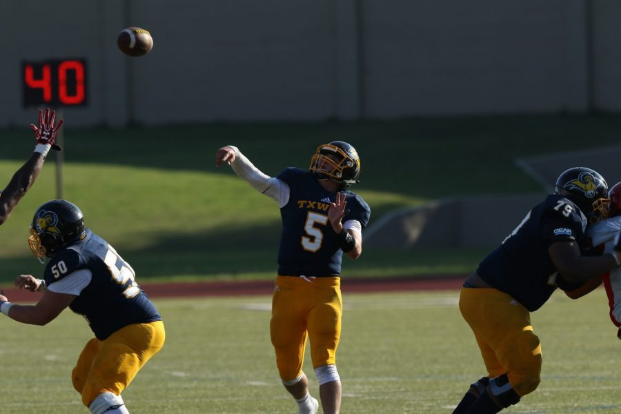 Erik Richards throws a pass in the homecoming game against Bacone College. Photo by Little Joe