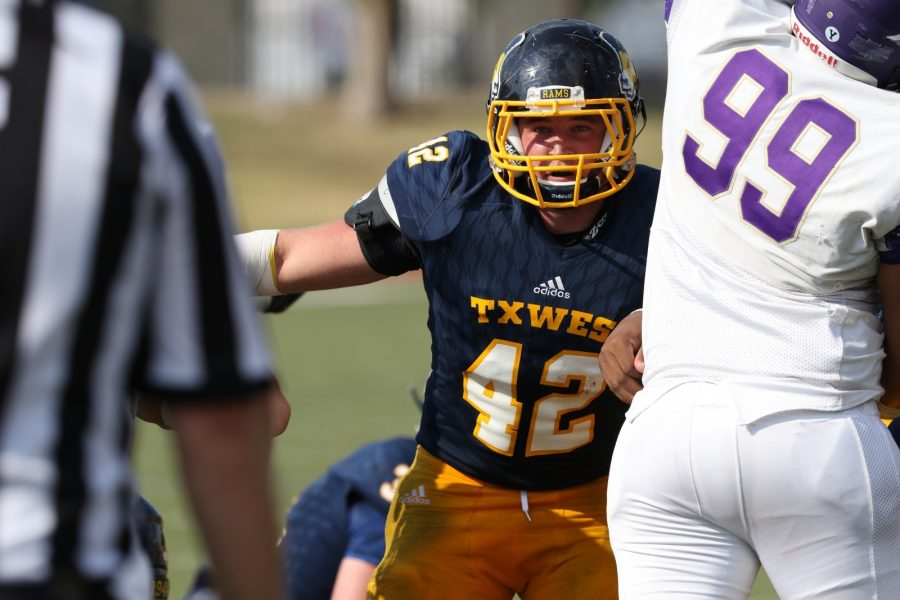 Tristen Blake prepares to make a tackle in the Southwestern Assemblies of God University game.  Photo by Little Joe