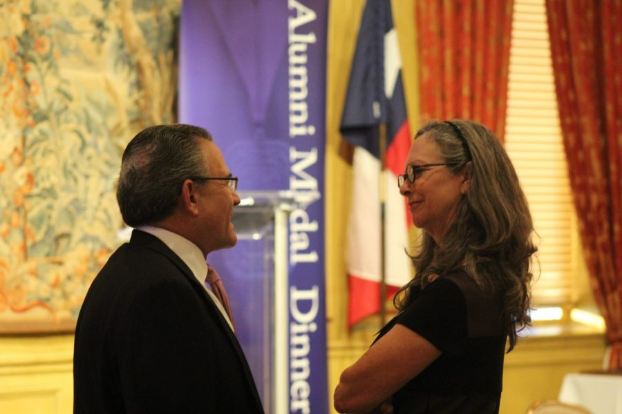 Alumni speak before Medal Dinner begins. photo by Heather Olivia Shannon