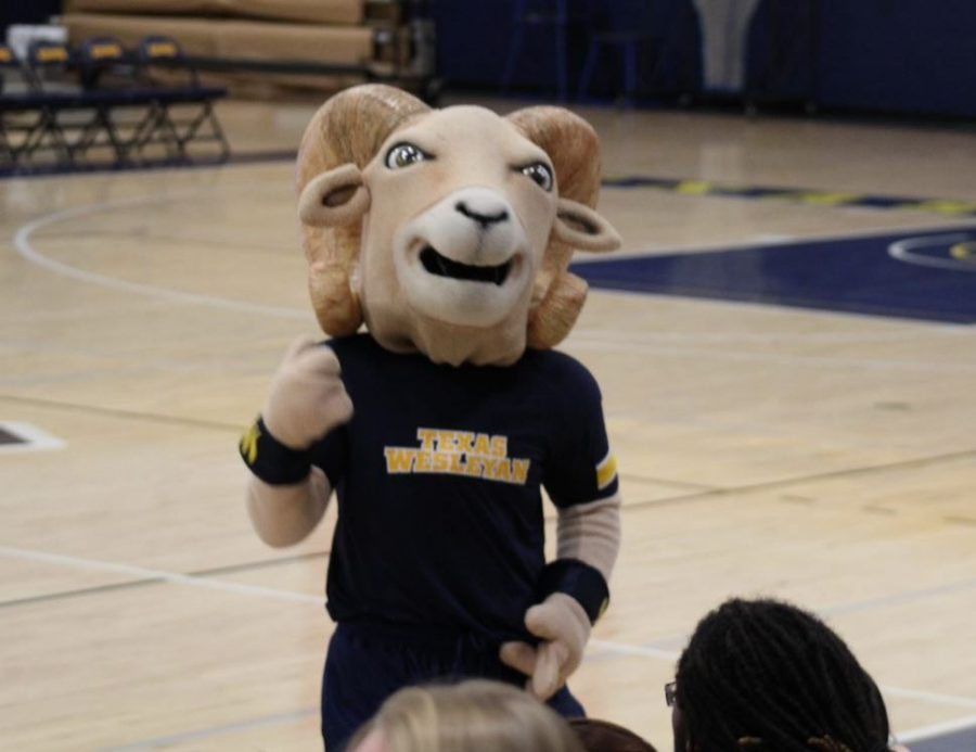 Willie the Ram gets the members of the crowd pumped up for the game. Photo by Tina Huynh
