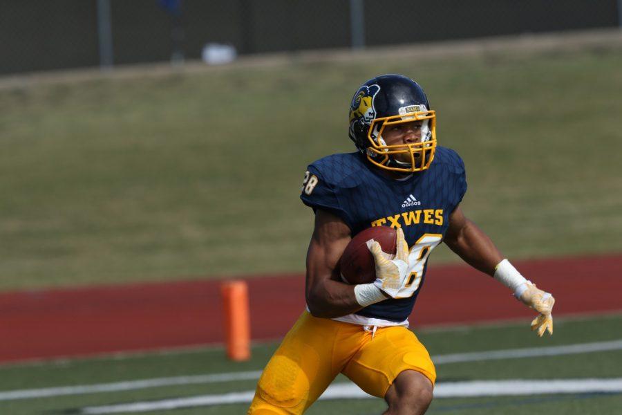 Trey Jackson returns a third quarter punt for a touchdown against Arizona Christian University on Saturday. Photo by Little Joe