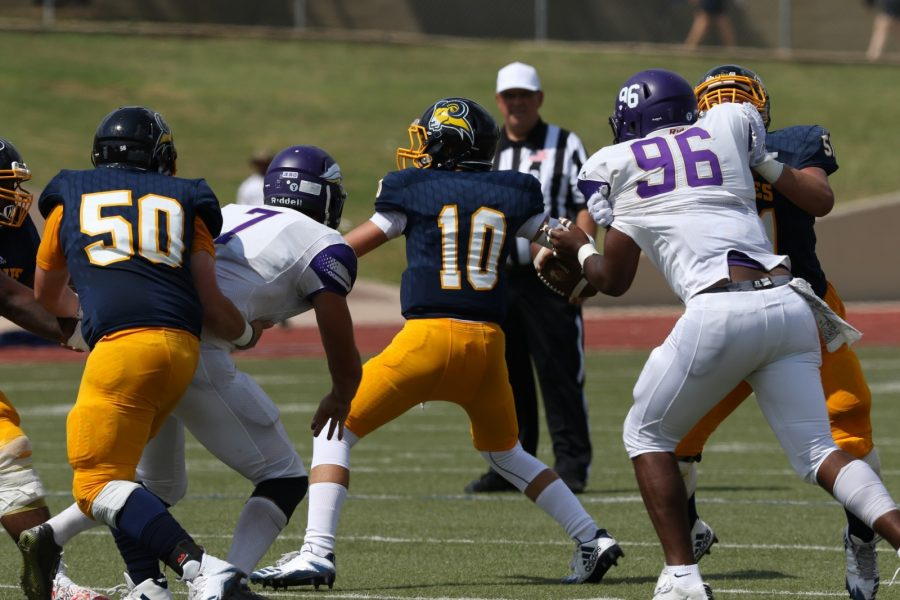 Kane Hardin (10) quarterback throws the ball while the offensive line holds off Southwestern Assemblies of God University. Photo by Little Joe