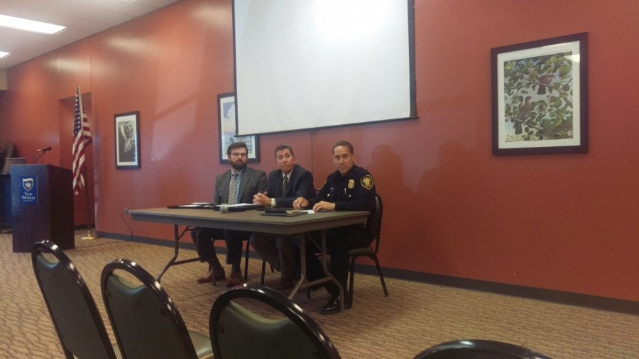 Dennis Hall, Chris Beckrich, and Michael Shedd talk during the safety and security forum. Photo by Hannah Onder