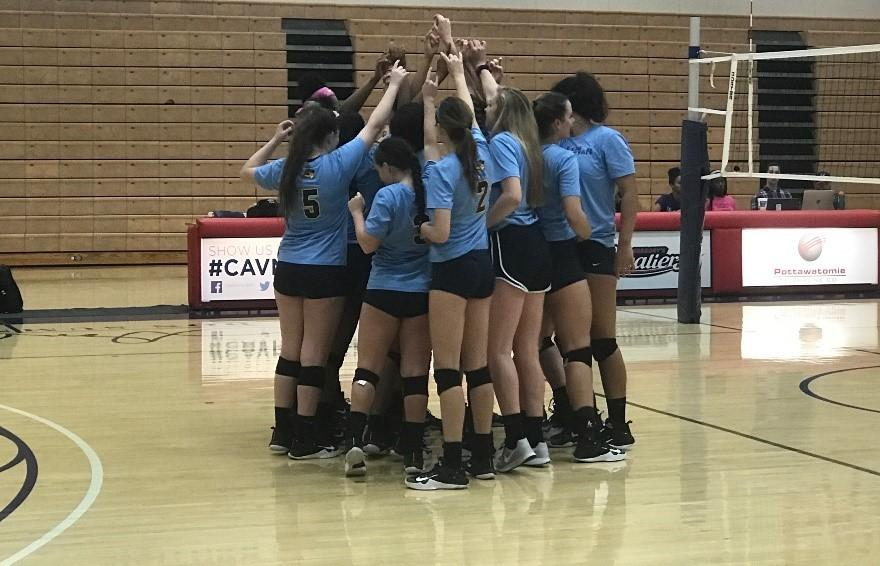 Members of the Lady Rams volleyball team come together during the St. Gregorys University match on Oct. 13. Photo by Mattie Morris