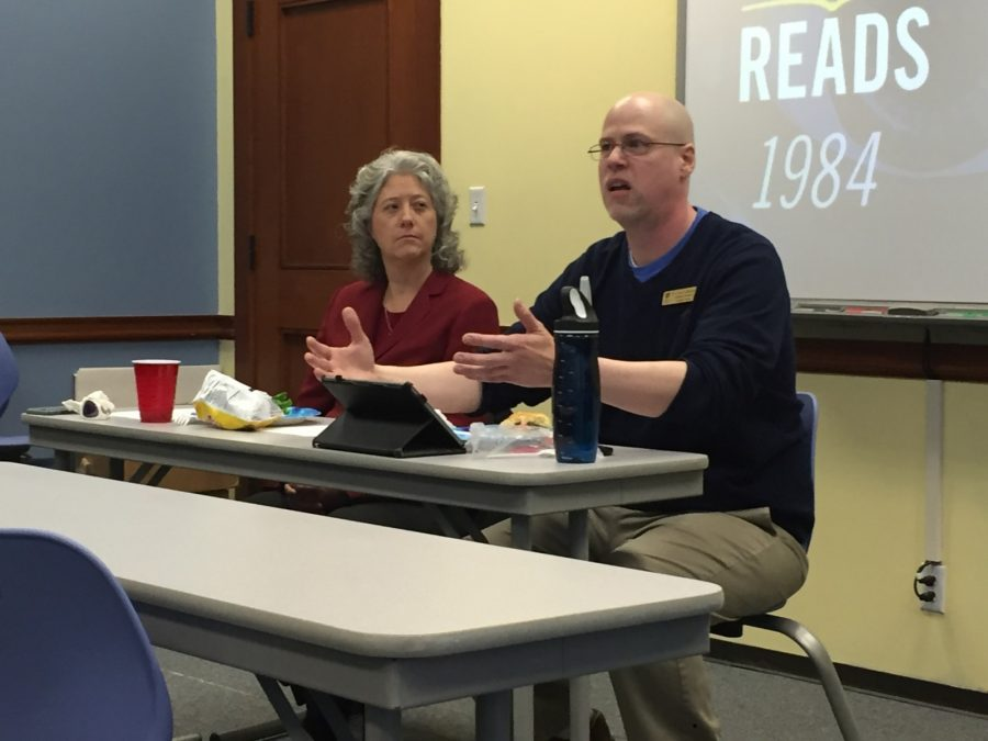 Dr. Kay Colley and Dr. Cary Adkinson discuss how the book 1984 relates to the present. Photo by Massaran Kromah