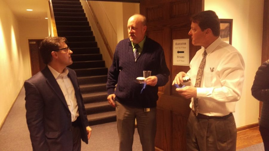 Dr. Mark Hanshaw (left) greets Dr. Steven Daniell (center) and President Frederick Slabach (right) at his goodbye party. Photo by Hannah Onder