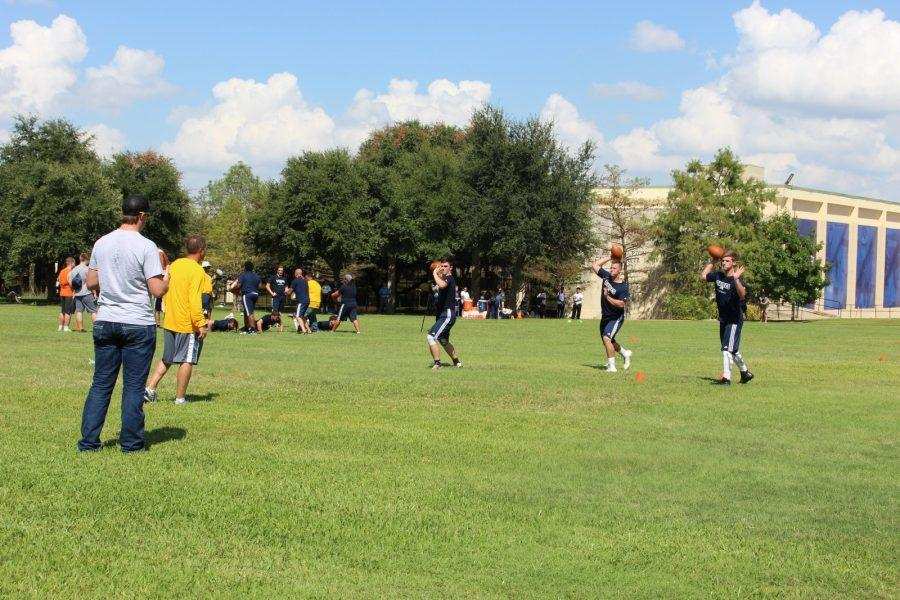 Three Rams quarterbacks, including Justin Arth (left) and Erik Richards (middle) throw the ball during the football teams first practice, which was in fall 2016. Photo by Karan Muns