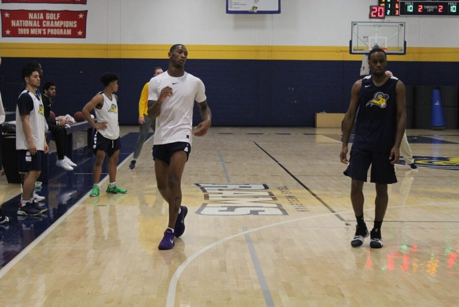 Branded Jenkins (white shirt) practices the Wednesday before the Southwestern Christian University game on Feb. 10. Photo by Karan Muns