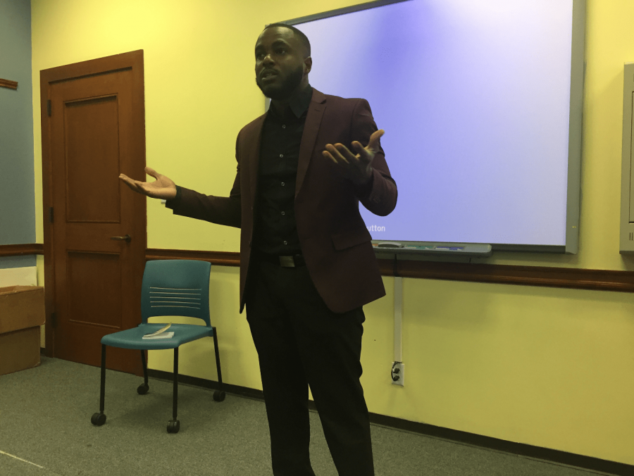Louie T. McClain II, founder and CEO of Melanin Origins, reflects on his childhood during his presentation. Photo by Massaran Kromah