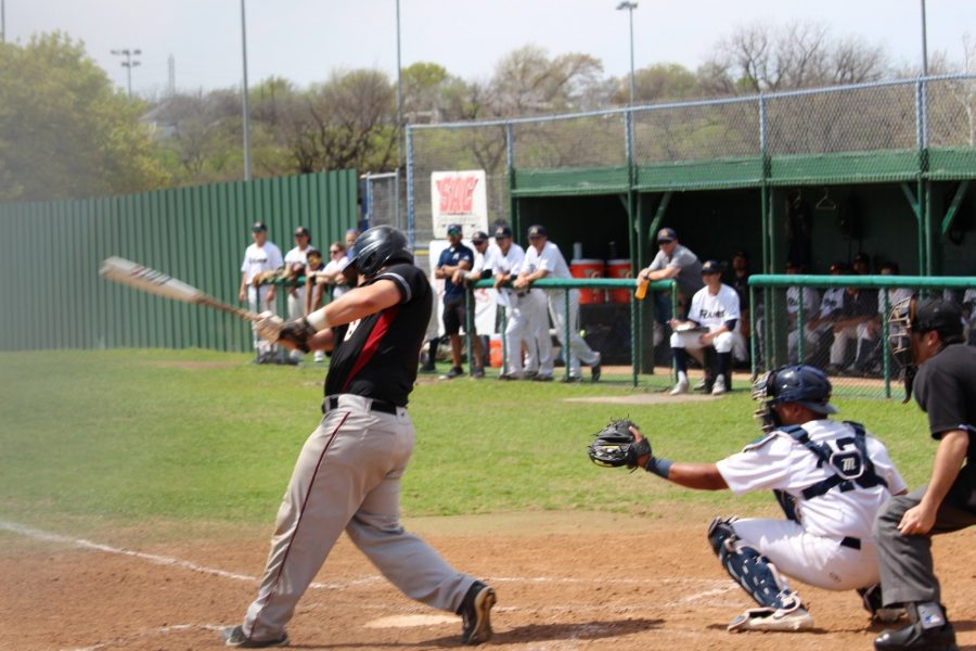 Catcher Ellis Boyer at the plate behind a Dallas Christian University hitter at the game on Saturday at 2 p.m.  Photo by Matt Smith.