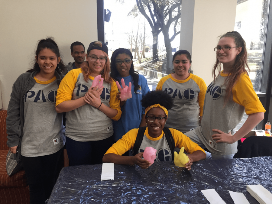 The PAC organization, including Alanna James (far right) pose with wax hands they made.  Photo by Massaran Kromah